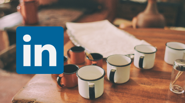 Mugs on a table with the LinkedIn logo superimposed on top