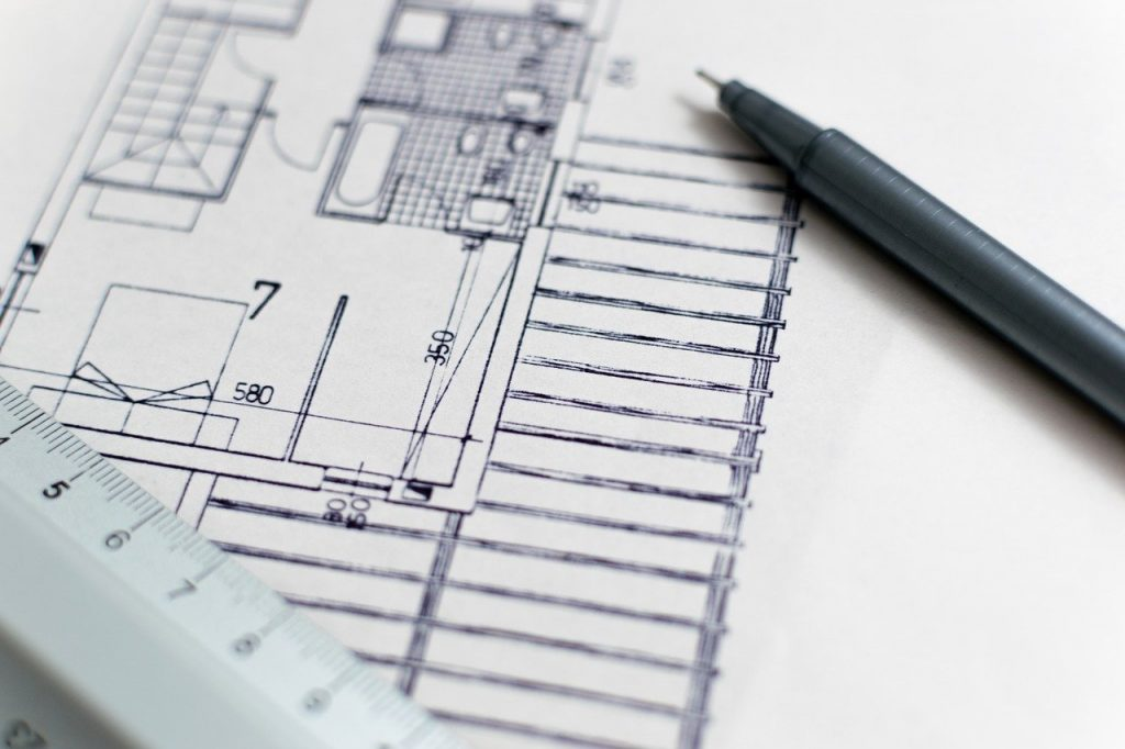 Architectural blueprint and pencil
