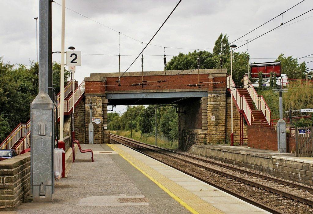 Railway platform with a bridge over the track